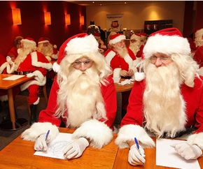 Professional Father Christmas performers gather for an annual Santa School in London.