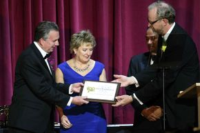 Camera assistant Sarah Jones' parents Richard and Elizabeth Jones receive a plaque accepting Sarah as an honorary member of the Society of Camera Operators on March 8, 2014.
