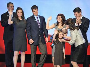 The Palin family (l-r), son Track, daughter Bristol (with boyfriend Levi Johnston), daughter Willow, son Trig, daughter Piper, Sarah and Todd Palin.