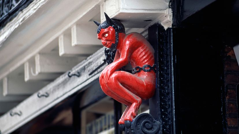 This Satan's characteristics, red with hooves and horns, partially evolved out of other religions' deities. DeAgostini/Getty Images