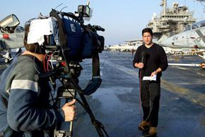 CNN reporter Frank Buckley does a live shot from the flight deck of the U.S.S. Constellation shortly after President George H.W. Bush delivered an address to the world March 18, 2003 in the Persian Gulf.