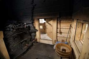 Welcome to the inside of a traditional Finnish savusauna, or wood-burning sauna. Note the smoke-blackened walls.
