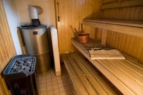 Note the rock-laden kiuas in this typical Finnish sauna. By ladling water onto the rocks, you can add more humidity to the room and make it feel even hotter. To cool off, you can also ladle the water on your body.