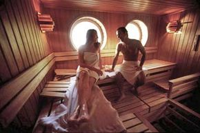 This couple opted to sauna toweled. However, it's worth noting that we have no idea how naked the photographer is.