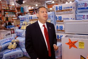 Then-U.S. Energy Secretary Spencer Abraham touts the benefits of installing proper insulation at a Home Depot store in 2003. See more pictures related to green living.