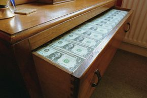 Since savings accounts don't have maximum limits, there's no need to stash extra cash in your dresser drawers (or under your bed).