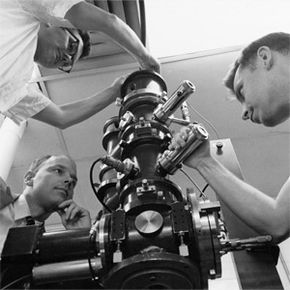 From left to right, Oliver C. Wells, Thomas E. Everhart and R.K. Matta gathered in 1963 around the first successful scanning electron microscope that they developed.