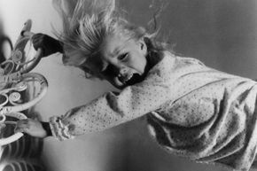 """Carol Anne (played by Heather O'Rourke) tries to prevent the TV people from scooping her up in """"Poltergeist."""""""