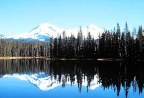 The North and Middle Sisters can be seen beyond Scott Lake from the McKenzie/Santiam Pass Scenic Byway.