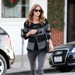 Throw a big chunky sweater over a pair of leggings, like Nicky Hilton does here.