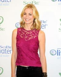 A bright lace top goes well with black pants, as worn by actress Yvonne Strahovski.