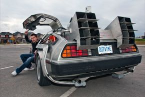 """Ken Kapalowski In his replica of the DeLorean time machine from """"Back To The Future."""""""
