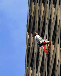 Real-life French Spider-Man Alain Robert doesn't need any special adhesives to scale walls. He just uses his bare hands.