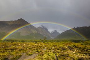 A rainbow looks like an arc as you can't see the bottom half because of the ground.  In the air, it might look like a disk.
