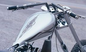 Gray handlebars, frame, and trim accent the silver metalflake paint.