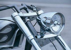 Chromed teardrop headlight is a chopper mainstay.