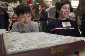 Nick Amphlett and John Ezekowitz, both 12 years old, react to their victory at the National School Scrabble Championship.