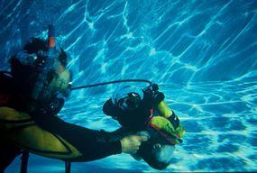 "Gene helps Hawkeye perform a trick called ""float in pool."""