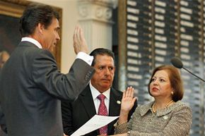 """Texas Secretary of State Esperanza """"Hope"""" Andrade, right, is sworn in on Sept. 18, 2008, in Austin."""