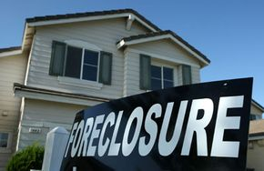 Foreclosure sign in front of home in Stockton, Calif.