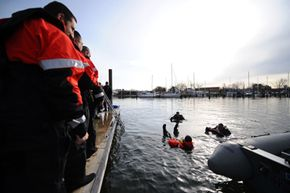 Participants in the 7th annual Search and Rescue Forum, hosted by the U.S. Coast Guard and Virginia Port Authority, undergo maritime search and rescue training.