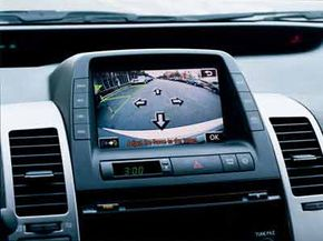 The British Toyota Prius with Intelligent Parking Assist has a dashboard screen to tell the driver what to do. See more car safety pictures.