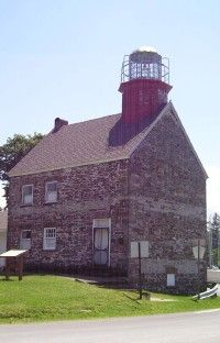 With its weathered gray-and-black rock, pitched, slate-covered roof, and short, red tower, the Selkirk Lighthouse resembles something from a Norman Rockwell painting. See more lighthouse pictures.