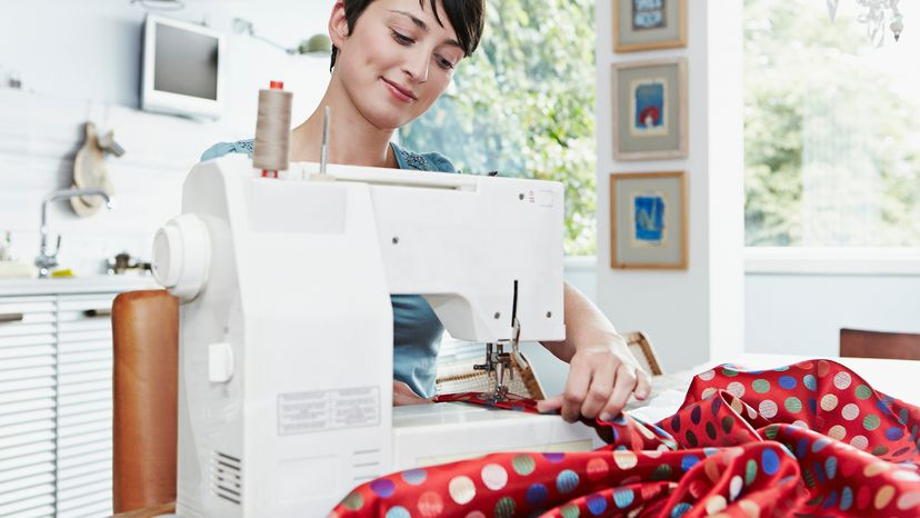 Woman sewing fabric on sewing machine