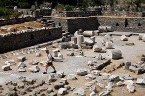 A tourist walks through the ruins of the Mausoleum of Halicarnassus in Bodrum, Turkey.
