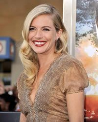Sienna Miller demonstrates some of the principles of shabby chic dressing:  muted colors, ruching and retro styling.
