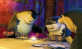 Don Lino (Robert De Niro) and his older son Frankie (Micael Imperioli) try to teach Lenny (Jack Black) how to eat like a shark.