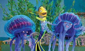 Oscar (Will Smith, center) with the jellies Ernie and Bernie (Ziggy Marley, left, and Doug E. Doug)