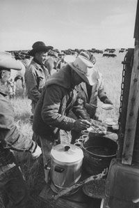 Cowboys are fed from the chuck wagon (ostensibly by a man named Cookie) Not pictured: the dinner bell.