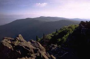 National Parks Image Gallery Craggy rock outcroppings on top of the Blue Ridge Mountains are composed of granite that is more than a billion years old. See more pictures of national parks.