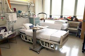 At Shepherd Center, patients with paralysis in their arms and hands can still operate TVs, telephones and nurse-call buttons by sipping or puffing into a straw that controls the equipment. Ceiling lifts also help nurses and therapists easily transfer a patient from wheelchair to bed or from bed to wheelchair.