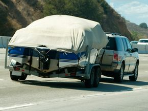Proper gear selection can make towing a large object, like this boat, much less demanding on the tow vehicle.