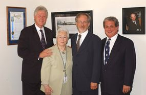 Left to right: Bill Clinton, survivor Renee Firestone, Steven Spielberg, and Douglas Greenberg