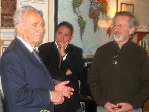 Shimon Peres, Nobel Peace Prize laureate and former Prime Minister of Israel (below left), visited the Shoah Foundation in January 2004. Here, he chats with Israeli Consul General Yuval Rotem and Steven Spielberg in the Foundation's Education Department.