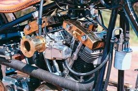 The engine's valve covers duplicate those of a Harley-Davidson Shovelhead V-twin, but are tinted gold, matching the hand-turned velocity stack on the S&S carburetor.
