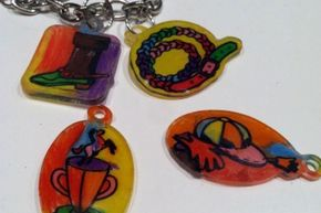 Some Shrinky Dinks kits come with designs already printed on the plastic. All you have to do is color them in and pop them in the oven.