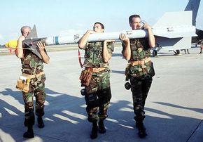 Airmen transport the compact, 190-pound Sidewinder.