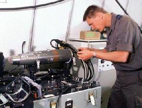 A Dutch air force armament technician repairs the guidance system on an AIM-9 Sidewinder.
