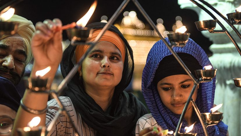 Sikhs light candles, India
