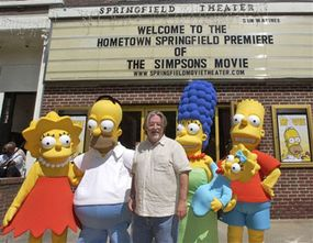 """""""Simpsons"""" creator Matt Groening (center) at the premiere of """"The Simpsons Movie"""" in Springfield, Vt."""