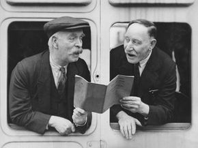 Two Welsh members of the Men's Choir of the Great Western Railway Institute practice aboard a rail carriage. Singing in choral groups establishes a support system.