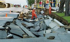 A broken water main collapsed part of the street in Los Angeles in December 2002. Sinkholes caused by water eroding the foundation of streets are a big problem in Los Angeles.