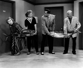 """Vivian Vance, Lucille Ball, Desi Arnaz and William Frawley hold a tuna fishing contest on an episode of """"I Love Lucy"""" from 1956."""