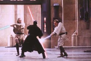 Sith Lord Darth Maul battles two Jedi at once.