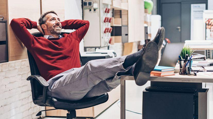 man relaxing in chair