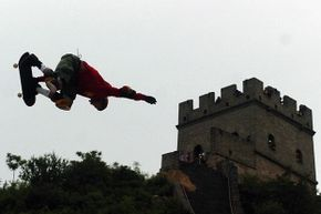 Danny Way jumps the Great Wall in Beijing, China – just one of our 10 amazing skateboarding feats.